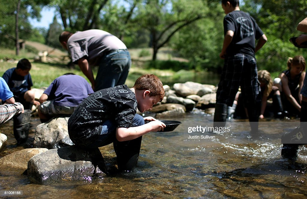 Tyler Williams pans for gold at Gold Prospecting Adventures May 6 2008 on Woods Creek in Jamestown California With gold trading near $900 per ounce...