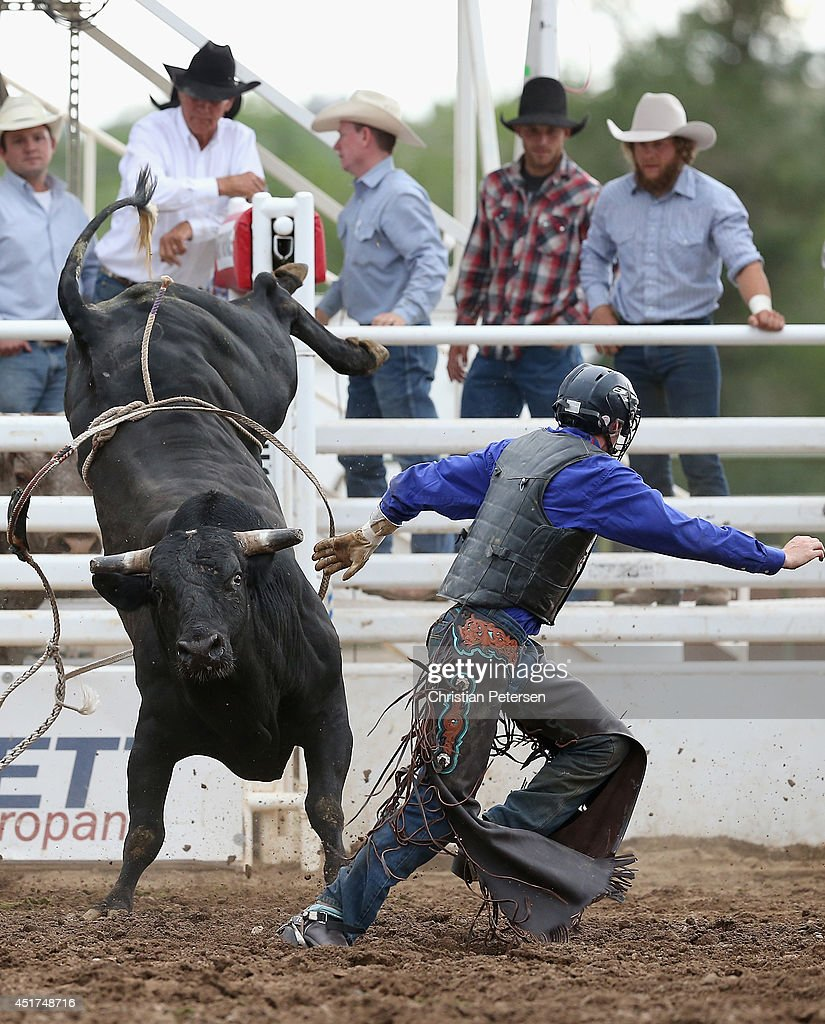 Tyler Willis runs from his bull after competing in the Bull Riding at the Prescott Frontier Days 'World's Oldest Rodeo' on July 5, 2014 in Prescott, Arizona.