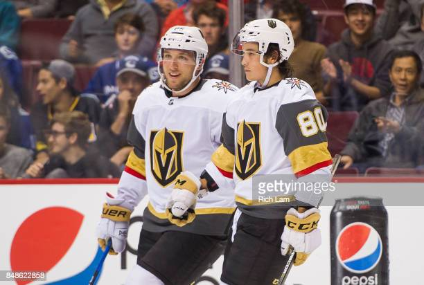 Tyler Wong of the Las Vegas Golden Knights is congratulated by teammate Stefan Matteau after scoring his third goal of the game against the Vancouver...