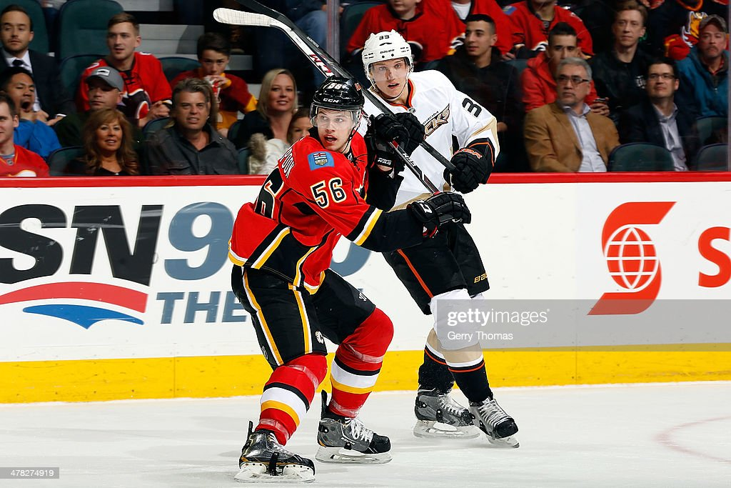 Tyler Wotherspoon #56 of the Calgary Flames skates against <a gi-track='captionPersonalityLinkClicked' href=/galleries/search?phrase=Jakob+Silfverberg&family=editorial&specificpeople=5894639 ng-click='$event.stopPropagation()'>Jakob Silfverberg</a> #33 of the Anaheim Ducks at Scotiabank Saddledome on March 12, 2014 in Calgary, Alberta, Canada.