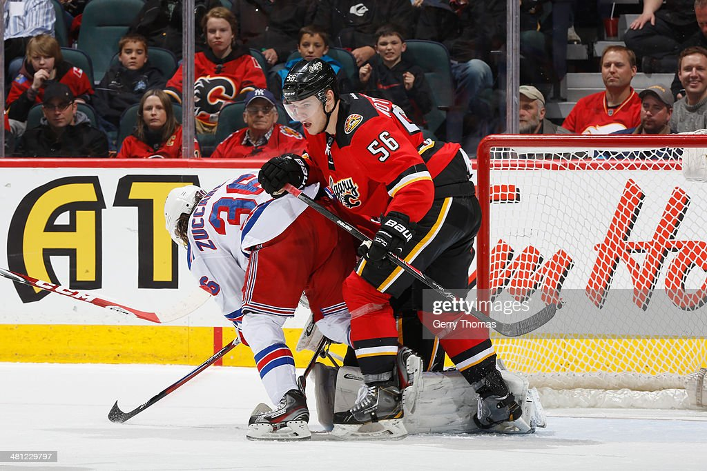 Tyler Wotherspoon #56 of the Calgary Flames skates against <a gi-track='captionPersonalityLinkClicked' href=/galleries/search?phrase=Mats+Zuccarello&family=editorial&specificpeople=7219903 ng-click='$event.stopPropagation()'>Mats Zuccarello</a> #36 of the New York Rangers at Scotiabank Saddledome on March 28, 2014 in Calgary, Alberta, Canada.