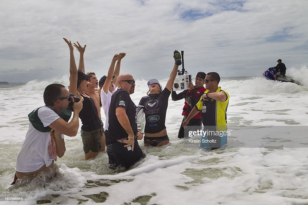 <a gi-track='captionPersonalityLinkClicked' href=/galleries/search?phrase=Tyler+Wright&family=editorial&specificpeople=212765 ng-click='$event.stopPropagation()'>Tyler Wright</a> of Australia (black) celebrates her victory at the Roxy Pro on March 9, 2013 in Gold Coast, Australia.
