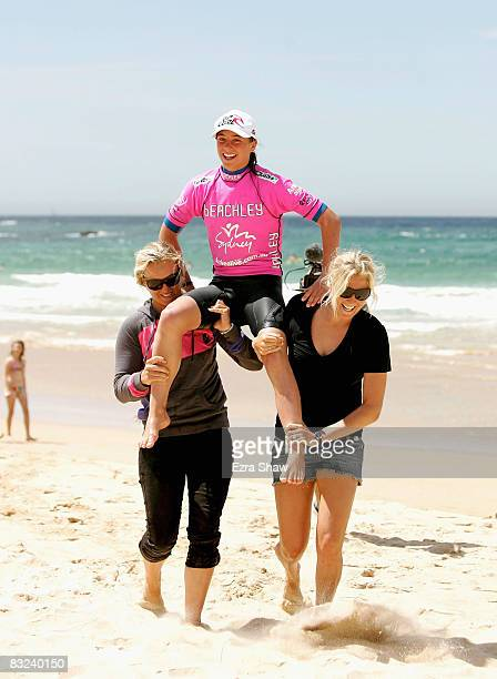 Tyler Wright of Australia is carried off the beach by Stephanie Gilmore and Jessi MylieDyer after winning the 2008 Beachley Classic at Manly Beach on...