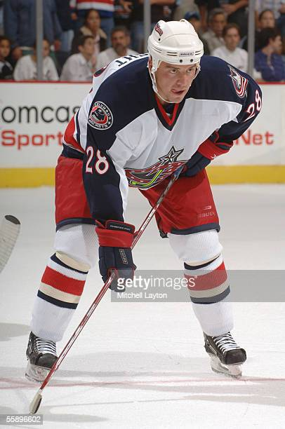 Tyler Wright of the Columbus Blue Jackets gets set for a face off against the Washington Capitals during the NHL game on October 5 2005 at MCI Center...