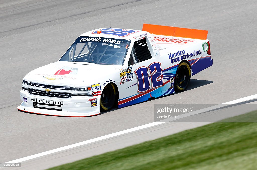 Tyler Young, driver of the Interlock Tech Solutions/Randco Chevrolet, practices for the NASCAR Camping World Truck Series 16th Annual Toyota Tundra 250 on May 05, 2016 in Kansas City, Kansas.