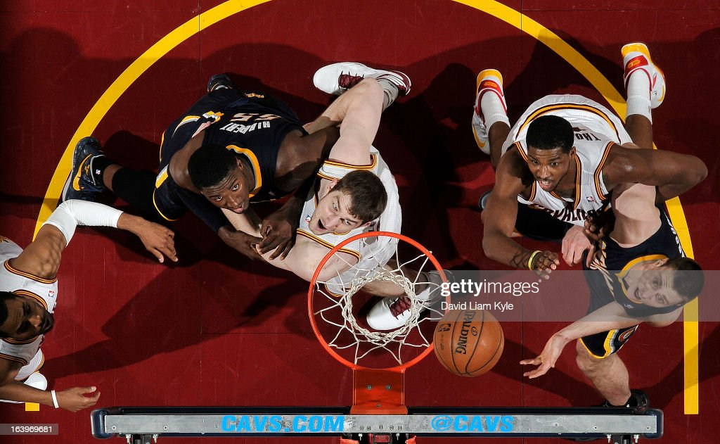 Tyler Zeller #40 and Tristan Thompson #13 of the Cleveland Cavaliers box out for the rebound against Roy Hibbert #55 and Tyler Hansbrough #50 of the Indiana Pacers at The Quicken Loans Arena on March 18, 2013 in Cleveland, Ohio.