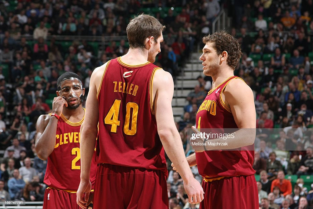 <a gi-track='captionPersonalityLinkClicked' href=/galleries/search?phrase=Tyler+Zeller&family=editorial&specificpeople=5122156 ng-click='$event.stopPropagation()'>Tyler Zeller</a> #40, <a gi-track='captionPersonalityLinkClicked' href=/galleries/search?phrase=Luke+Walton&family=editorial&specificpeople=202565 ng-click='$event.stopPropagation()'>Luke Walton</a> #4 and <a gi-track='captionPersonalityLinkClicked' href=/galleries/search?phrase=Kyrie+Irving&family=editorial&specificpeople=6893971 ng-click='$event.stopPropagation()'>Kyrie Irving</a> #2 of the Cleveland Cavaliers talk on the court during the game against the Utah Jazz at Energy Solutions Arena on January 19, 2013 in Salt Lake City, Utah.