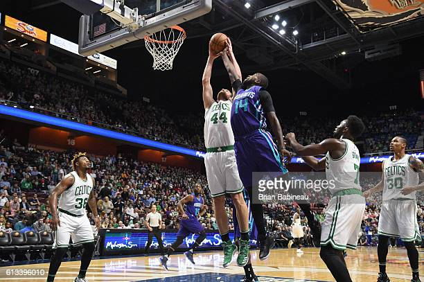 Tyler Zeller of the Boston Celtics blocks Michael KiddGilchrist of the Charlotte Hornets during a preseason game on October 8 2016 at the Mohegan Sun...