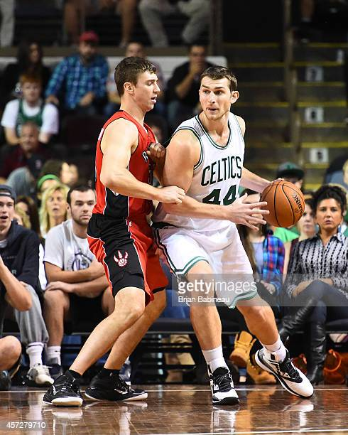 Tyler Zeller of the Boston Celtics defends the ball against the Toronto Raptors on October 15 2014 at the Cross Insurance Arena in Portland Maine...