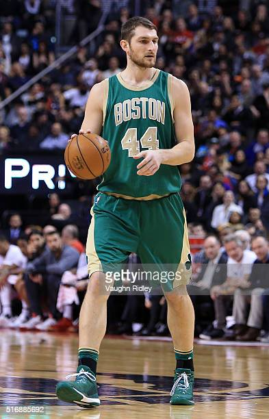 Tyler Zeller of the Boston Celtics dribbles the ball during the second half of an NBA game against the Toronto Raptors at the Air Canada Centre on...