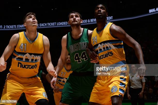 Tyler Zeller of the Boston Celtics fights for position against Juancho Hernangomez and Roy Hibbert of the Denver Nuggets on March 10 2017 at the...