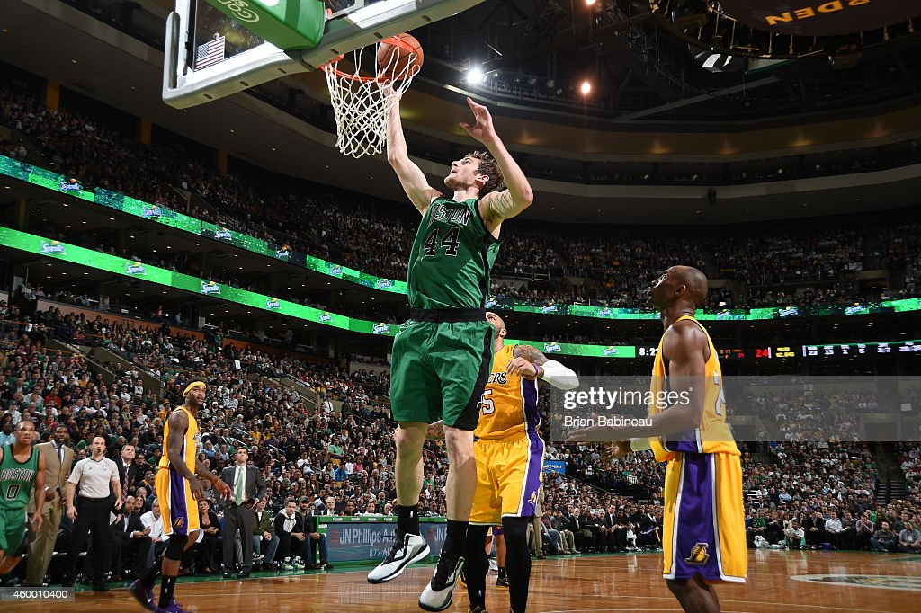 Tyler Zeller of the Boston Celtics goes up for a shot against the Los Angeles Lakers on December 5 2014 at the TD Garden in Boston Massachusetts NOTE...