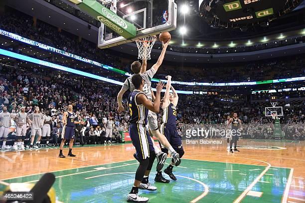 Tyler Zeller of the Boston Celtics goes up for the game winning shot against the Utah Jazz on March 4 2015 at TD Garden in Boston Massachusetts NOTE...