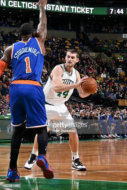 Tyler Zeller of the Boston Celtics handles the ball against the Los Angeles Clippers on December 12 2014 at the TD Garden in Boston Massachusetts...