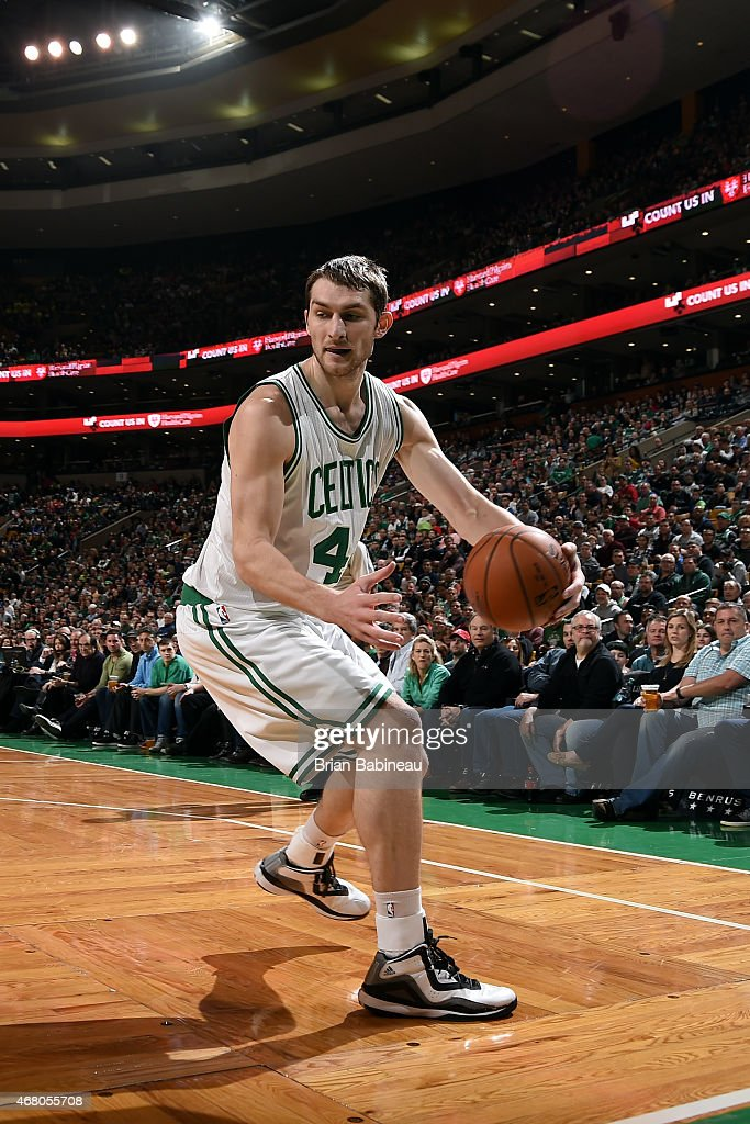 Tyler Zeller of the Boston Celtics handles the ball against the Los Angeles Clippers on March 29 2015 at TD Garden in Boston Massachusetts NOTE TO...