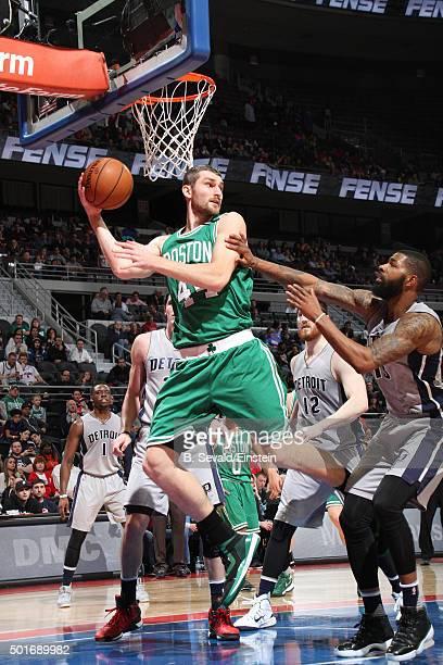 Tyler Zeller of the Boston Celtics passes the ball against the Detroit Pistons on December 16 2015 at The Palace of Auburn Hills in Auburn Hills...