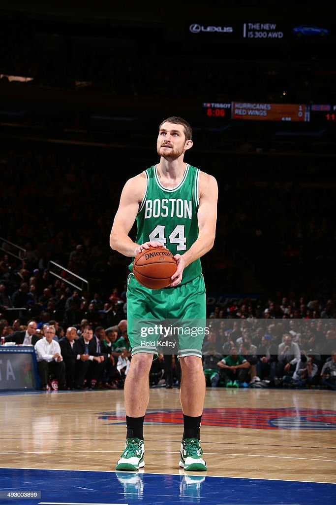 Tyler Zeller of the Boston Celtics shoots a free throw against the New York Knicks during a preseason game on October 16 2015 at Madison Square...