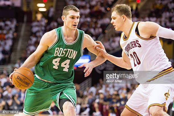 Tyler Zeller of the Boston Celtics tries to drive around Timofey Mozgov of the Cleveland Cavaliers in the second half during Game Two in the Eastern...