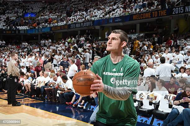 Tyler Zeller of the Boston Celtics warms up before the game against the Cleveland Cavaliers in Game One of the Eastern Conference Quarterfinals...