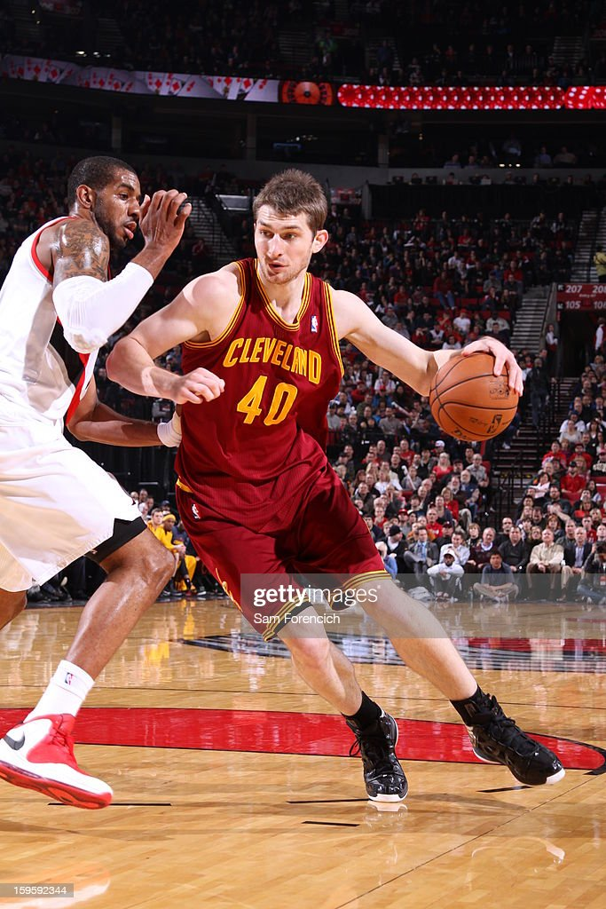Tyler Zeller #40 of the Cleveland Cavaliers drives to the basket against LaMarcus Aldridge #12 of the Portland Trail Blazers on January 16, 2013 at the Rose Garden Arena in Portland, Oregon.