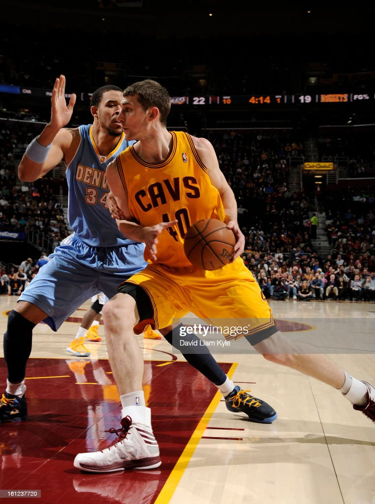 Tyler Zeller #40 of the Cleveland Cavaliers drives to the hoop against JaVale McGee #34 of the Denver Nuggets at The Quicken Loans Arena on February 9, 2013 in Cleveland, Ohio.