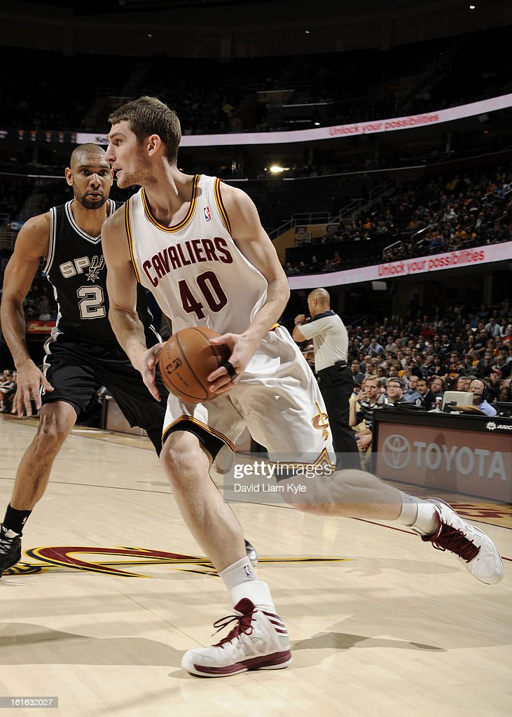 Tyler Zeller #40 of the Cleveland Cavaliers drives to the hoop against Tim Duncan #21 of the San Antonio Spurs at The Quicken Loans Arena on February 13, 2013 in Cleveland, Ohio.