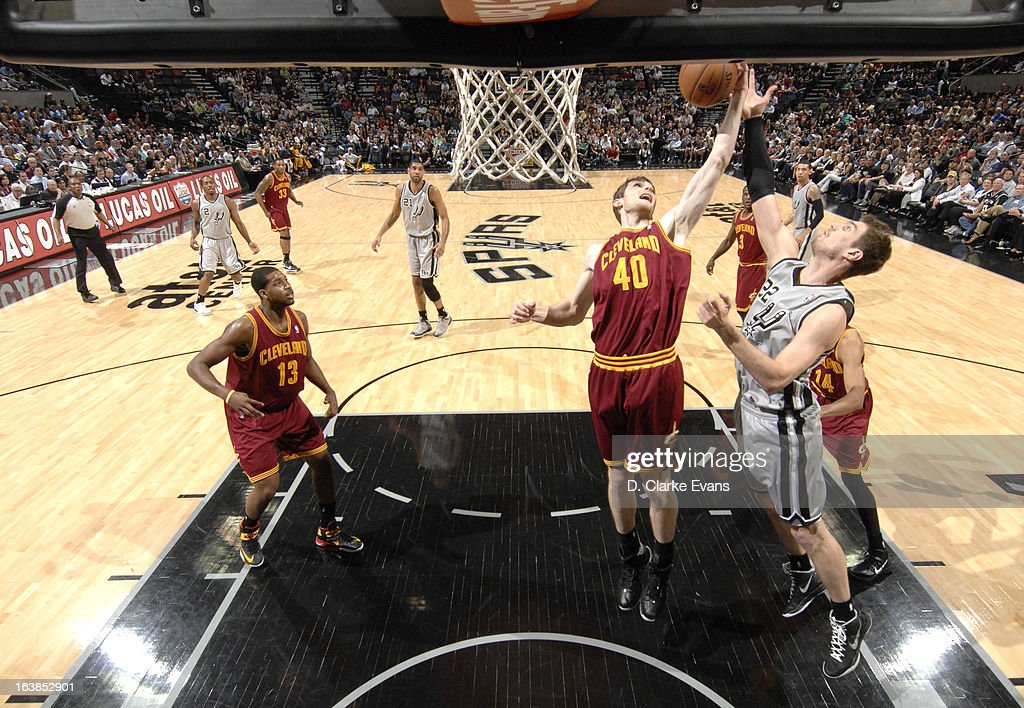 Tyler Zeller #40 of the Cleveland Cavaliers goes to the basket against Tiago Splitter #22 of the San Antonio Spurs during the game between the Cleveland Cavaliers and the San Antonio Spurs on March 16, 2013 at the AT&T Center in San Antonio, Texas.