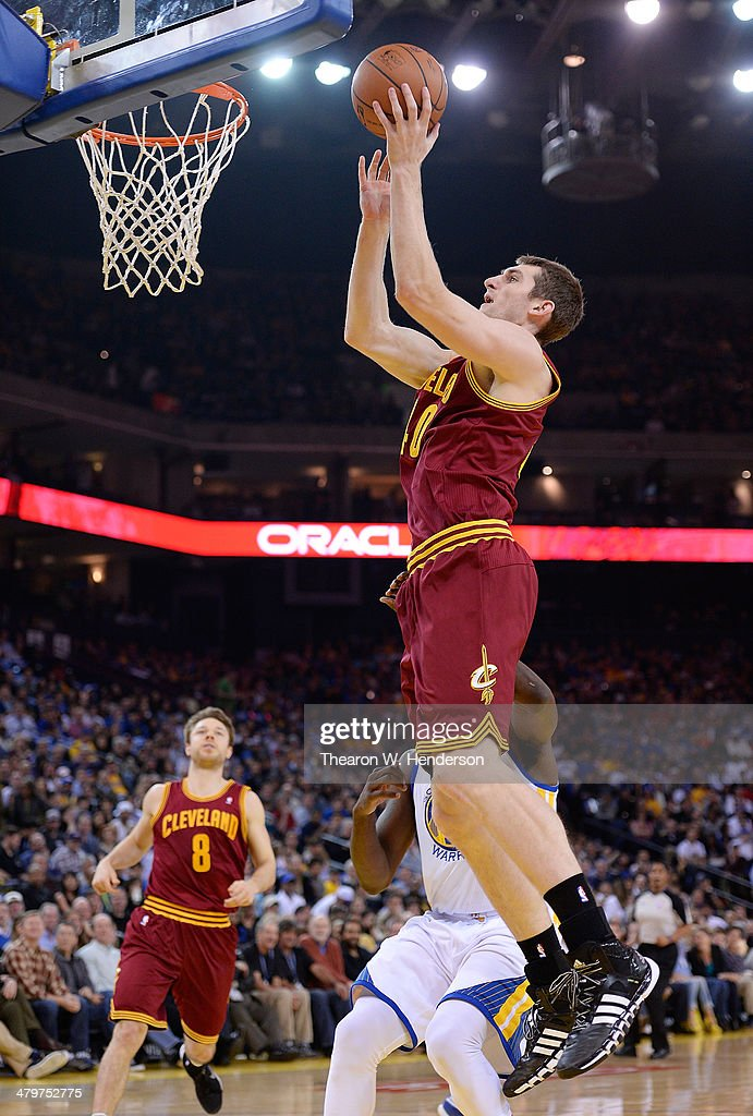 Tyler Zeller of the Cleveland Cavaliers goes up to shoot against the Golden State Warriors at ORACLE Arena on March 14 2014 in Oakland California...