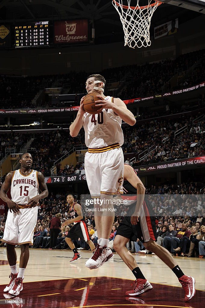 <a gi-track='captionPersonalityLinkClicked' href=/galleries/search?phrase=Tyler+Zeller&family=editorial&specificpeople=5122156 ng-click='$event.stopPropagation()'>Tyler Zeller</a> #40 of the Cleveland Cavaliers grabs a rebound against the Portland Trail Blazers at The Quicken Loans Arena on December 1, 2012 in Cleveland, Ohio.