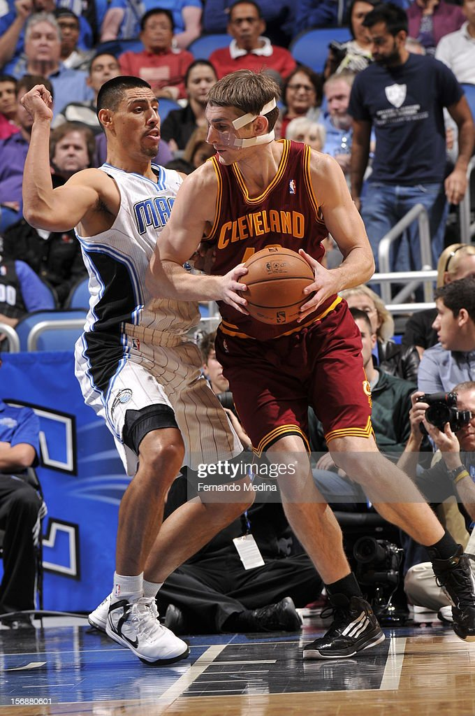 Tyler Zeller #40 of the Cleveland Cavaliers looks to make a move against Gustavo Ayon #19 of the Orlando Magic on November 23, 2012 at Amway Center in Orlando, Florida.