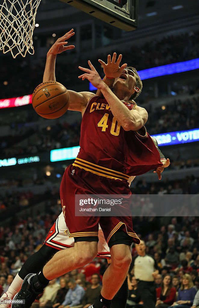 Tyler Zeller of the Cleveland Cavaliers looses the ball after being fouled by Carlos Boozer of the Chicago Bulls at the United Center on January 7...