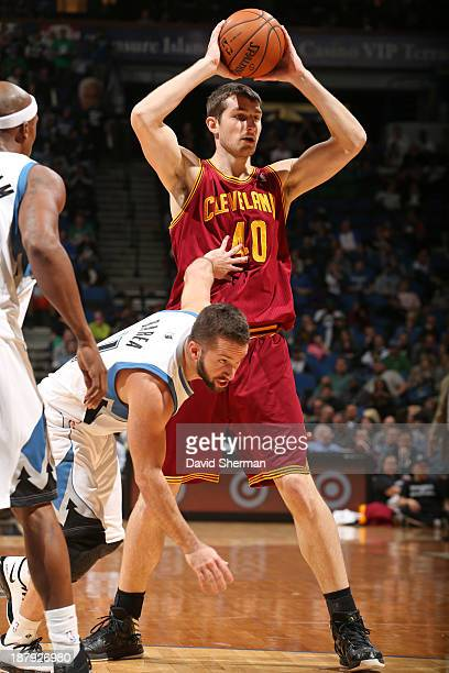 Tyler Zeller of the Cleveland Cavaliers passes the ball against the Minnesota Timberwolves on November 13 2013 at Target Center in Minneapolis...