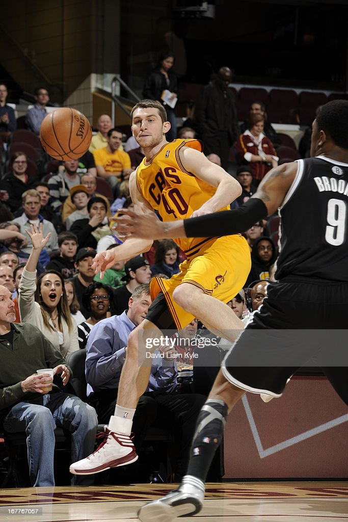 <a gi-track='captionPersonalityLinkClicked' href=/galleries/search?phrase=Tyler+Zeller&family=editorial&specificpeople=5122156 ng-click='$event.stopPropagation()'>Tyler Zeller</a> #40 of the Cleveland Cavaliers passes the ball before going out of bounds against MarShon Brooks #9 of the Brooklyn Nets at The Quicken Loans Arena on April 3, 2013 in Cleveland, Ohio.