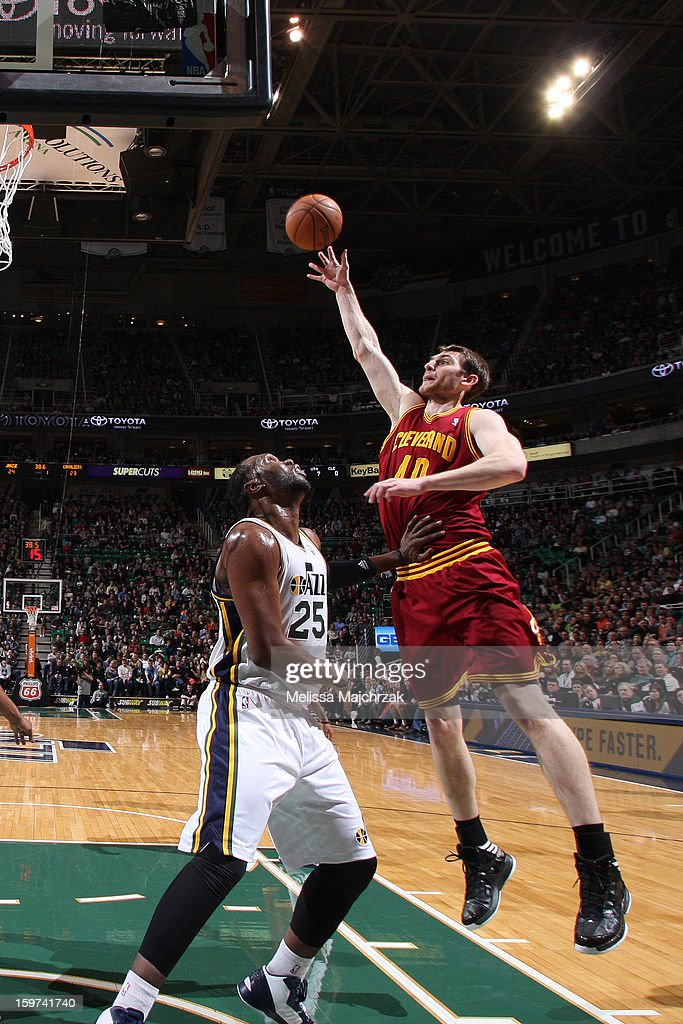 Tyler Zeller #40 of the Cleveland Cavaliers shoots against Al Jefferson #25 of the Utah Jazz at Energy Solutions Arena on January 19, 2013 in Salt Lake City, Utah.