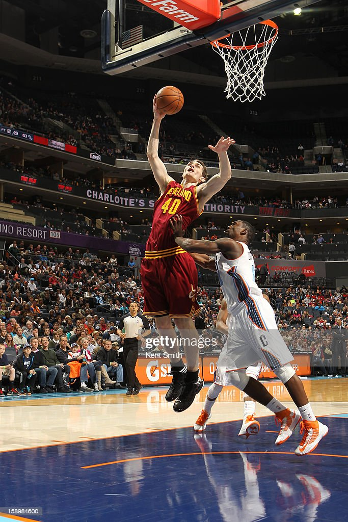 Tyler Zeller #40 of the Cleveland Cavaliers shoots against Ben Gordon #8 of the Charlotte Bobcats at the Time Warner Cable Arena on January 4, 2013 in Charlotte, North Carolina.