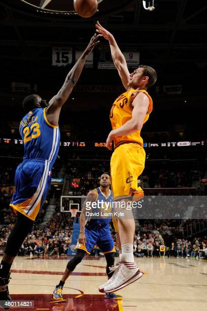 Tyler Zeller of the Cleveland Cavaliers shoots against the Golden State Warriors at The Quicken Loans Arena on December 29 2013 in Cleveland Ohio...