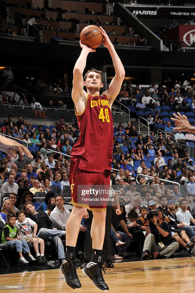<a gi-track='captionPersonalityLinkClicked' href=/galleries/search?phrase=Tyler+Zeller&family=editorial&specificpeople=5122156 ng-click='$event.stopPropagation()'>Tyler Zeller</a> #40 of the Cleveland Cavaliers shoots against the Orlando Magic on February 23, 2013 at Amway Center in Orlando, Florida.