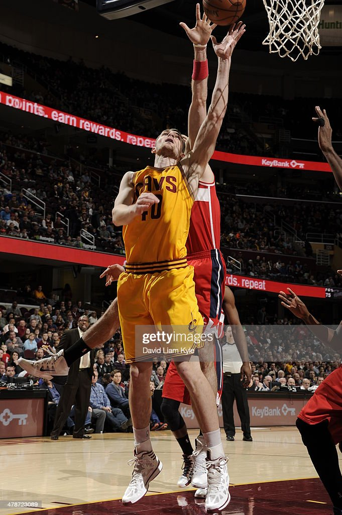 <a gi-track='captionPersonalityLinkClicked' href=/galleries/search?phrase=Tyler+Zeller&family=editorial&specificpeople=5122156 ng-click='$event.stopPropagation()'>Tyler Zeller</a> #40 of the Cleveland Cavaliers takes a shot against the Washington Wizards at The Quicken Loans Arena on February 23, 2014 in Cleveland, Ohio.
