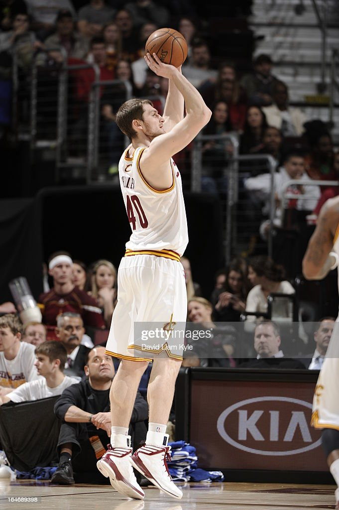 <a gi-track='captionPersonalityLinkClicked' href=/galleries/search?phrase=Tyler+Zeller&family=editorial&specificpeople=5122156 ng-click='$event.stopPropagation()'>Tyler Zeller</a> #40 of the Cleveland Cavaliers takes a shot against the Los Angeles Clippers at The Quicken Loans Arena on March 1, 2013 in Cleveland, Ohio.