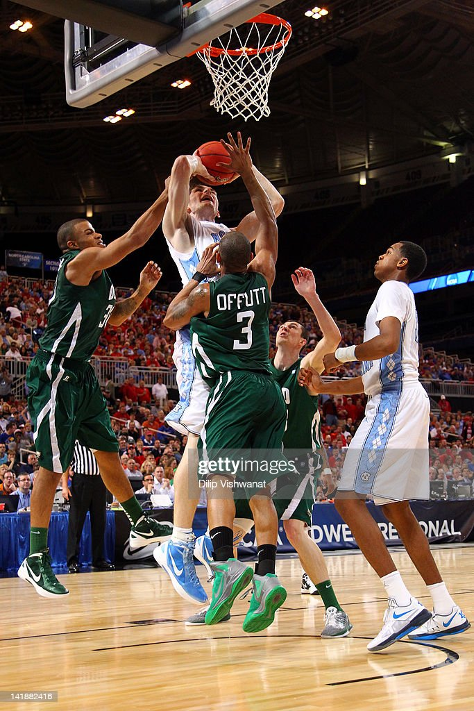 Tyler Zeller #44 of the North Carolina Tar Heels attempts a shot against Reggie Keely #30 and Walter Offutt #3 of the Ohio Bobcats during the 2012 NCAA Men's Basketball Midwest Regional Semifinal at Edward Jones Dome on March 23, 2012 in St. Louis, Missouri.