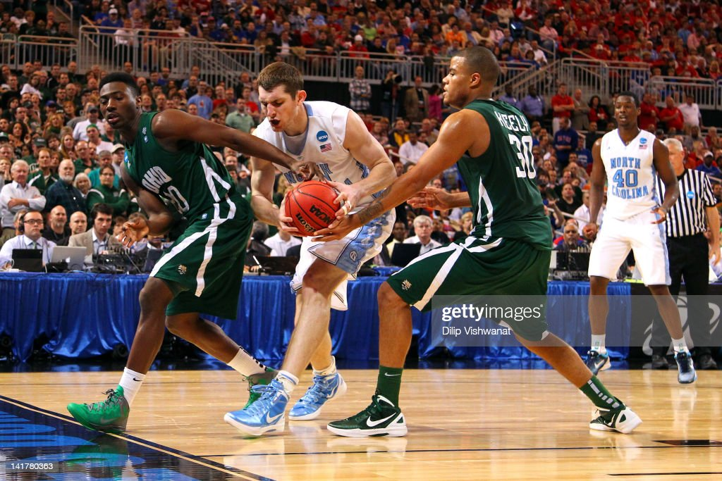 Tyler Zeller #44 of the North Carolina Tar Heels attempts to control the ball in the second half against Ricardo Johnson #20 and Reggie Keely #30 of the Ohio Bobcats during the 2012 NCAA Men's Basketball Midwest Regional Semifinal at Edward Jones Dome on March 23, 2012 in St. Louis, Missouri.