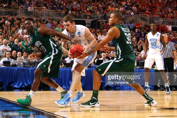 Tyler Zeller of the North Carolina Tar Heels attempts to control the ball in the second half against Ricardo Johnson and Reggie Keely of the Ohio...
