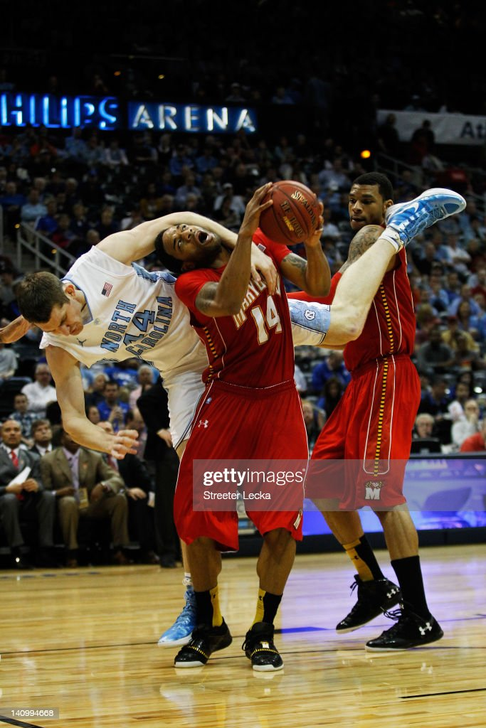 <a gi-track='captionPersonalityLinkClicked' href=/galleries/search?phrase=Tyler+Zeller&family=editorial&specificpeople=5122156 ng-click='$event.stopPropagation()'>Tyler Zeller</a> #44 of the North Carolina Tar Heels fouls Sean Mosley #14 of the Maryland Terrapins in the second half during the Quarterfinals of the 2012 ACC Men's Basketball Conferene Tournament at Philips Arena on March 9, 2012 in Atlanta, Georgia.
