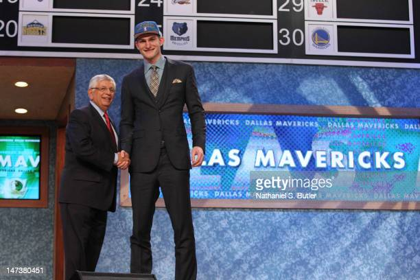 Tyler Zeller shakes hands with NBA Commissioner David Stern after being selected number seventeen overall by the Dallas Mavericks during the 2012 NBA...