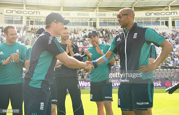 Tymal Mills of England receives his T20 International cap from England captain Eoin Morgan ahead of the Natwest International T20 match between...