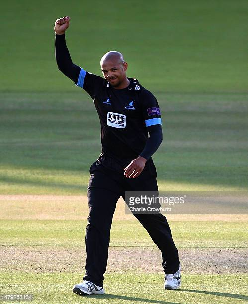 Tymal Mills of Sussex celebrates taking the wicket of Mitchell McClenaghan of Middlesex during the NatWest T20 Blast match between Middlesex and...