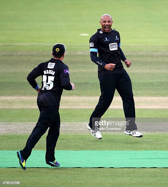 Tymal Mills of Sussex celebrates with team mate Matthew Machan after bowling out Middlesex's Nick Compton during the NatWest T20 Blast match between...