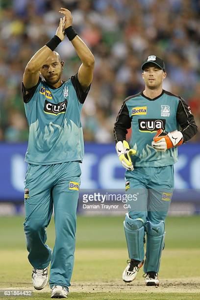 Tymal Mills of the Brisbane Heat celebrates the wicket of David Hussey of the Melbourne Stars during the Big Bash League match between the Melbourne...