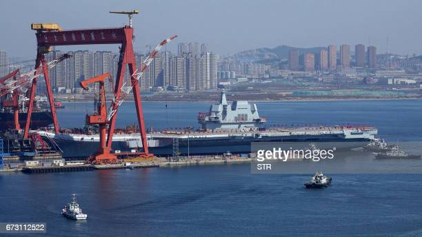 Type 001A China's second aircraft carrier is transferred from the dry dock into the water during a launch ceremony at Dalian shipyard in Dalian...