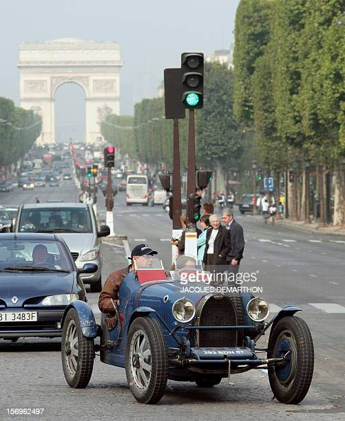 A type 35 Bugatti makes its way on the ChampsElysees Avenue on September 20 2009 in Paris at the end of a Bugatti rallye which started in Mulhouse...